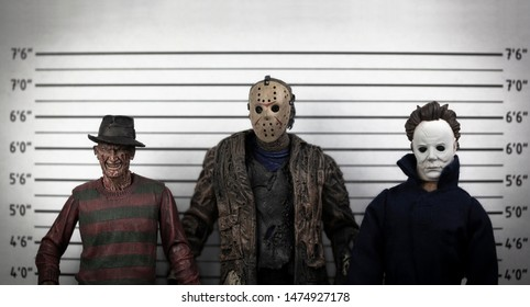AUG 9 2019: The usual suspects - horror movie mugshot lineup - Freddy Kruger, Jason Voorhees & Michael Myers - Neca and custom action figures