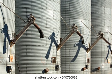 Augers on the side of massive grain bins at a grain elevator in Malta, Montana.