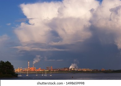 Aughinish Alumina, County Limerick / Ireland - October 10 2014:  Looming thunder cell over the processing plant