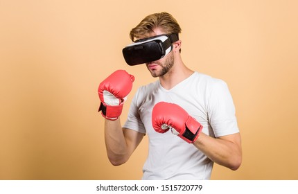 Augmented 3D world. Cyber sportsman boxing gloves. Man play game in VR glasses. Cyber sport concept. Man boxer virtual reality headset simulation. Cyber coach online training. Explore cyber space.