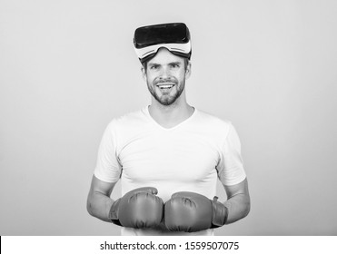 Augmented 3D world. Man boxer virtual reality headset simulation. Man play game in VR glasses. Explore cyber space. Cyber sport concept. Cyber coach online training. Cyber sportsman boxing gloves.