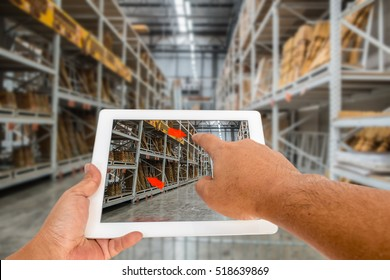 Augmented reality application for retail business concept. Hand holding digital tablet with A/R application on screen to finding interested product in construction depot.