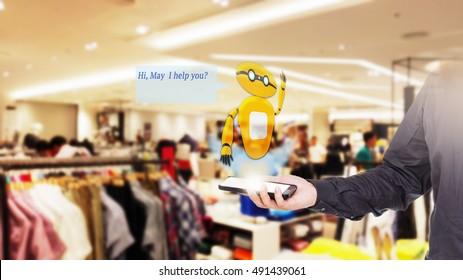 Augmented reality chatbot for retail business concept. Man holding smart phone with A/R chatbot and greeting message on blur men wear shop background.