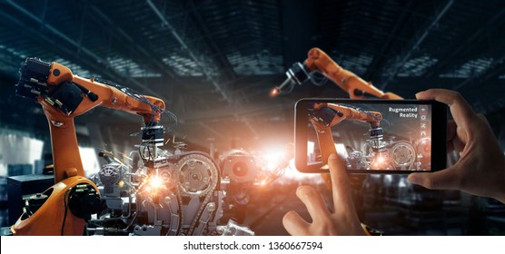 Augmented reality industrial concept. Smart phone use AR application to check and control robotics automatic arms machine in factory automotive industrial with monitoring system software. Industry 4.0