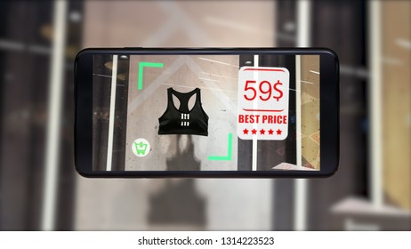 Augmented reality marketing concept. Hand holding smart phone use AR application to check relevant information check sale price in retail fashion shop.