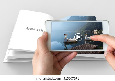 Augmented reality marketing concept. Hand holding smart phone use AR application to play video for customer.