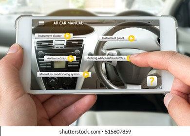 Augmented reality marketing , customer relationship concept. Hand holding smart phone use AR application to check manual of inside car for customer. Flare light.