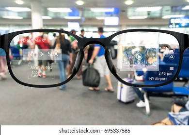 Augmented reality marketing and smart AR glasses technology concept. Customer using AR application to monitoring , check , alert  airline flight. Blur Airport background