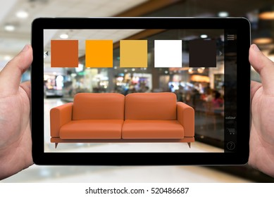 Augmented reality marketing technology for access entire product inventory in-store concept. Hand holding tablet use AR application for simulate furniture and colour in retail store. 3D rendering