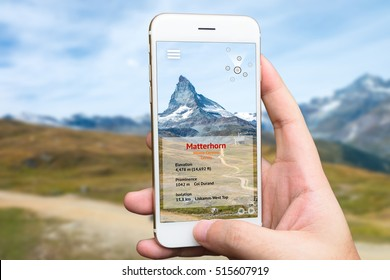 Augmented reality marketing and travel 4.0 concept. Hand holding smart phone use AR application to check relevant information about the spaces around customer. Matterhorn mountain background