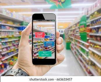 Augmented reality for smart retail business concept.hands holding mobile phone on blurred supermarket as background
