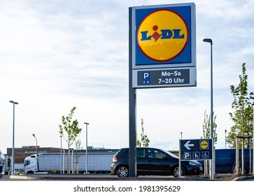Augsburg, Bayern, Germany - 20 May 2021: LIDL company logo with opening hours - LIDL German Food Discounter - Schwarz Group