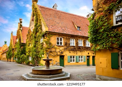 Augsburg: Fuggerei, October 26, 2018. The world oldest social housing. Bavaria, Germany