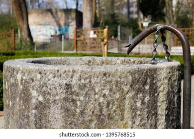 Augsburg, Germany - April 1, 2019: Small stone fountain in the Park am Roten Tor (Translation: Park at the Red Gate) in Augsburg's city center