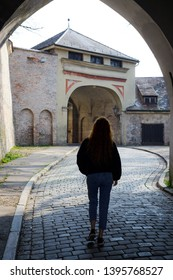 Augsburg, Germany - April 1, 2019: Woman walking through the Rotes Tor (Translation: Red Gate) in Augsburg's city center