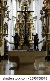 Augsburg, Germany - April 1, 2019: Altar in front of the crucifix in the Basilica St. Ulrich and Afra in Augsburg's city center