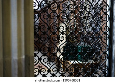 Augsburg, Germany - April 1, 2019: View through iron door with ornaments into small chapel inside of the Basilica St. Ulrich and Afra in Augsburg's city center