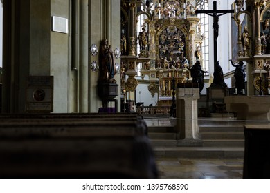 Augsburg, Germany - April 1, 2019: Ambo and wooden church pews inside the Basilica St. Ulrich and Afra in Augsburg's city center