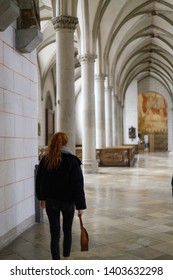 Augsburg, Germany - April 12, 2019: Woman walking along the aisle of the Augsburger Dom (Translation: Cathedral of Augsburg)