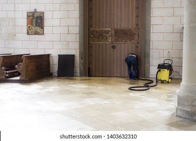 Augsburg, Germany - April 12, 2019: Janitor with machine to clean the marble floor of the Augsburger Dom (Translation: Cathedral of Augsburg)
