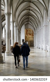 Augsburg, Germany - April 12, 2019: Man and woman walking along the aisle of the Augsburger Dom (Translation: Cathedral of Augsburg)