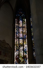 Augsburg, Germany - April 12, 2019: Stained-glass church window in the Augsburger Dom (Translation: Cathedral of Augsburg) in Augsburg's city center