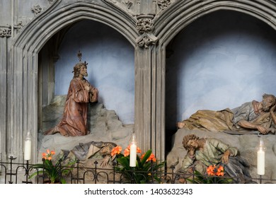 Augsburg, Germany - April 12, 2019: Religious wooden sculptures in the Augsburger Dom (Translation: Cathedral of Augsburg)