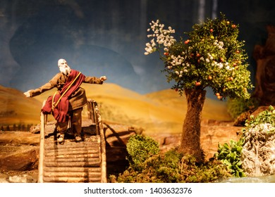Augsburg, Germany - April 12, 2019: Based on a bible story a male figurine is standing next to a tree on a wooden bridge in the sand in the Augsburger Dom (Translation: Cathedral of Augsburg)