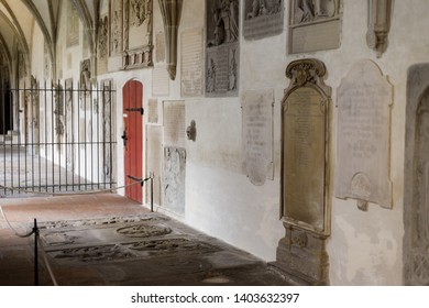 Augsburg, Germany - April 12, 2019: Tomb stones on the wall and the floor in a side corridor of the Augsburger Dom (Translation: Cathedral of Augsburg)