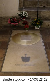 Augsburg, Germany - April 12, 2019: Tomb stone of an archbishop in a vault in the Augsburger Dom (Translation: Cathedral of Augsburg)