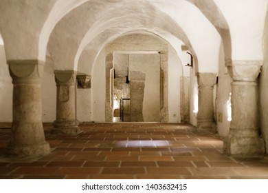 Augsburg, Germany - April 12, 2019: Inside of the vault with arches and columns underneath the Augsburger Dom (Translation: Cathedral of Augsburg)