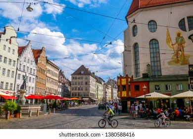 Augsburg, Germany - August 15, 2018 : Tourists and locals enjoying the city center at Moritzplatz, Augsburg