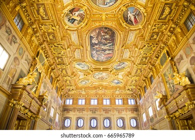 AUGSBURG, GERMANY - Dec. 23, 2015. The Goldener Saal canopied by a gilded and coffered ceiling interspersed with frescoes at the Rathaus in Augsburg.