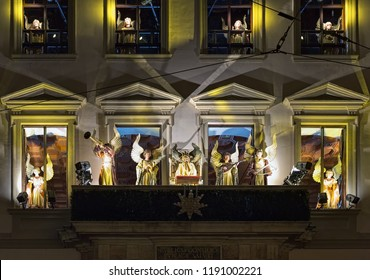 AUGSBURG, GERMANY - DECEMBER 16, 2017: The Angel Performance on the facade of Town Hall. It is a tradition of Augsburg Christmas market. The angels appear every Friday, Saturday and Sunday at 18:00.