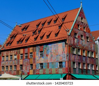 Augsburg, Germany - July 25, 2018: A vibrant, colorful building sits in downtown Augsburg, Germany.