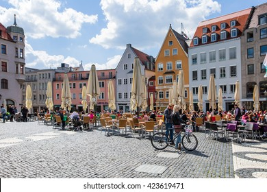 AUGSBURG, GERMANY - MAY 04, 2016: Tourists at the Rathausplatz in Augsburg, Germany