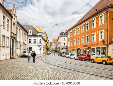 Augsburg, Germany - May 09, 2017: Street with tram tracks in the centre of Augsburg, Germany