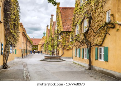 Augsburg, Germany - May 09, 2017: The Fuggerei is the world's oldest social housing complex in Augsburg.