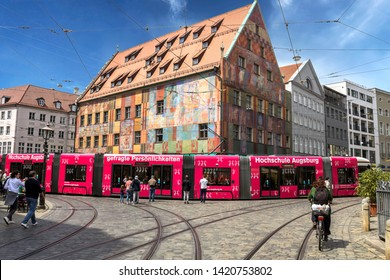 Augsburg, Germany - May 18, 2019: Old town with Weberhaus house and red tram in Augsburg. Augsburg is one of the oldest cities of Germany.