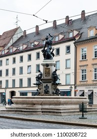 AUGSBURG, GERMANY - MAY 20, 2018: tourists near Herkulesbrunnen (Hercules fountain) on Maximilianstrasse street in Augsburg. Augsburg is a city in Swabia, Bavaria, it is third oldest city in Germany