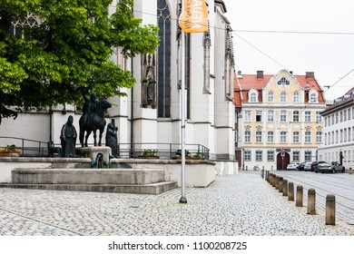 AUGSBURG, GERMANY - MAY 20, 2018: statues of Saint Afra, Bishop Simpert and Bishop Ulrich over fountain near Cathedral. Augsburg is a city in Swabia, Bavaria, it is third oldest city in Germany