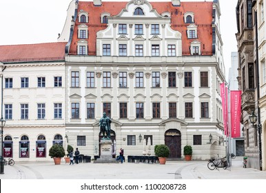 AUGSBURG, GERMANY - MAY 20, 2018: people near statue of Hans Jakob Fugger on Fuggerplatz in Augsburg town. Augsburg is a city in Swabia, Bavaria, it is third oldest city in Germany