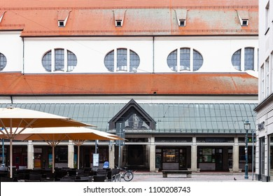 AUGSBURG, GERMANY - MAY 20, 2018: shops and cafe near Moritzkirche (St Moritz Church) on Moritzplatz square in Augsburg town. Augsburg is a city in Swabia, Bavaria, it is third oldest city in Germany