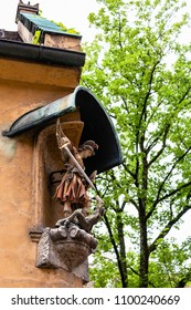 AUGSBURG, GERMANY - MAY 20, 2018: figure of archangel Michael in Fuggerei housing in Augsburg town. Augsburg is a city in Swabia, Bavaria, it is third oldest city in Germany