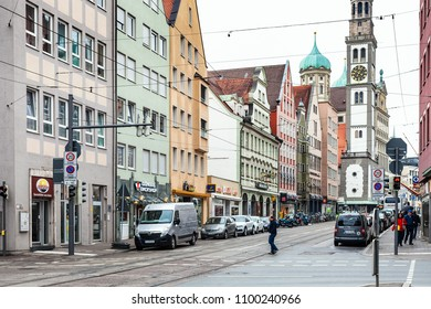 AUGSBURG, GERMANY - MAY 20, 2018: people on Karolinenstrasse and view of Perlachturm tower and Town Hall in Augsburg. Augsburg is a city in Swabia, Bavaria, it is third oldest city in Germany