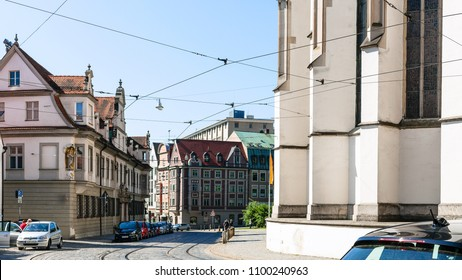 AUGSBURG, GERMANY - MAY 21, 2018: people and cars on Hoher Weg street near Cathedral in Augsburg town in sunny spring day. Augsburg is a city in Swabia, Bavaria, it is third oldest city in Germany
