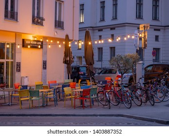 Augsburg, Germany - May 5, 2019: Outdoor arragement with colorful chairs, tables and lights from the bar Beim Weissen Lamm in Augsburg