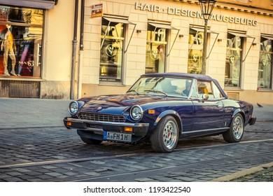 Augsburg, Germany - September 30, 2018: 1980 Fiat 124 Spider oldtimer car at the Fuggerstadt Classic 2018 Oldtimer Rallye.