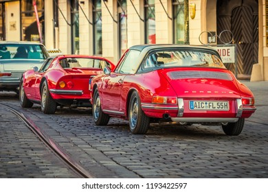 Augsburg, Germany - September 30, 2018: Porsche 911 and Ferrari Dino oldtimer cars at the Fuggerstadt Classic 2018 Oldtimer Rallye.