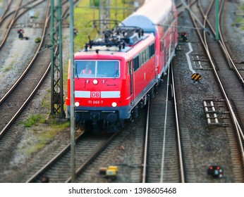 Augsburg, Germany - September 5, 2018: Red train from the German railway operator German railways Deutsche Bahn DB is leaving the central station in Augsburg